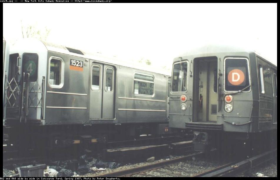 (65k, 952x612)<br><b>Country:</b> United States<br><b>City:</b> New York<br><b>System:</b> New York City Transit<br><b>Location:</b> Concourse Yard<br><b>Car:</b> R-62 (Kawasaki, 1983-1985)  1523 <br><b>Photo by:</b> Peter Dougherty<br><b>Date:</b> 1998<br><b>Notes:</b> R62 and R68 side by side<br><b>Viewed (this week/total):</b> 17 / 4615