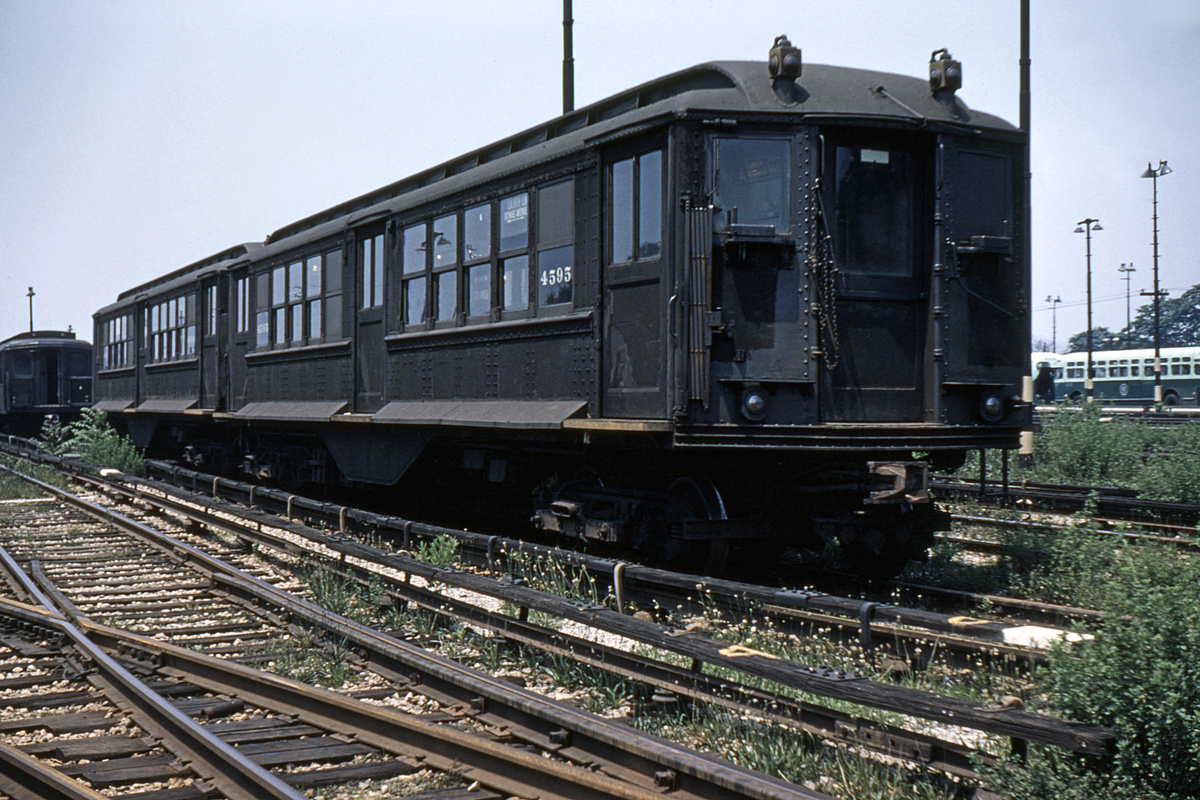 (471k, 1044x710)<br><b>Country:</b> United States<br><b>City:</b> New York<br><b>System:</b> New York City Transit<br><b>Location:</b> 36th Street Yard<br><b>Car:</b> BMT-Low V 4595 <br><b>Photo by:</b> Gerald H. Landau<br><b>Collection of:</b> David Pirmann<br><b>Date:</b> 6/5/1960<br><b>Notes:</b> Modified for use on BMT<br><b>Viewed (this week/total):</b> 0 / 3247