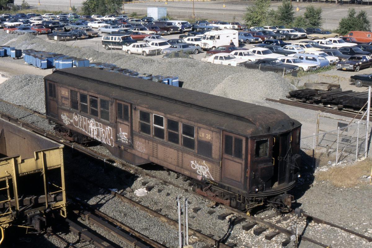 (591k, 1024x683)<br><b>Country:</b> United States<br><b>City:</b> New York<br><b>System:</b> New York City Transit<br><b>Location:</b> Corona Yard<br><b>Car:</b> Low-V LV35 (ex-5485)<br><b>Photo by:</b> Steve Hoskins<br><b>Collection of:</b> David Pirmann<br><b>Date:</b> 10/1980<br><b>Notes:</b> Work service<br><b>Viewed (this week/total):</b> 0 / 6384