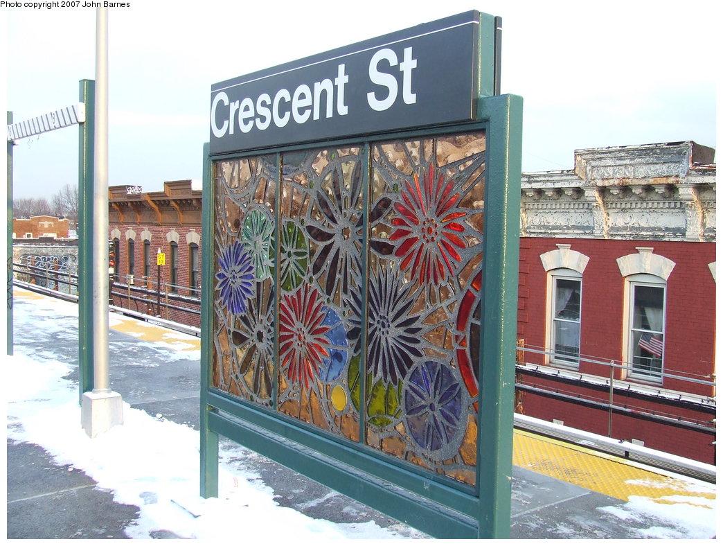 (223k, 1044x788)<br><b>Country:</b> United States<br><b>City:</b> New York<br><b>System:</b> New York City Transit<br><b>Line:</b> BMT Nassau Street/Jamaica Line<br><b>Location:</b> Crescent Street <br><b>Photo by:</b> John Barnes<br><b>Date:</b> 3/7/2007<br><b>Artwork:</b> <i>Wheel of Bloom; Soak up the Sun</i>, Jung Hyang Kim (2007).<br><b>Viewed (this week/total):</b> 4 / 2062