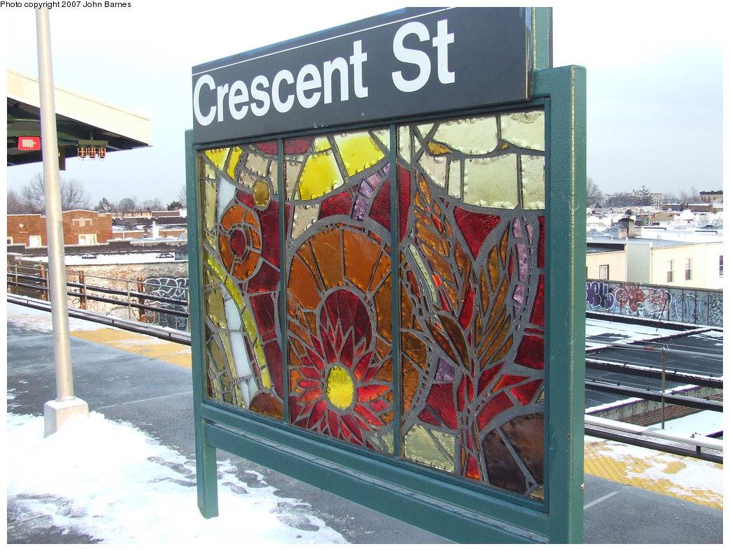 (220k, 1044x788)<br><b>Country:</b> United States<br><b>City:</b> New York<br><b>System:</b> New York City Transit<br><b>Line:</b> BMT Nassau Street/Jamaica Line<br><b>Location:</b> Crescent Street <br><b>Photo by:</b> John Barnes<br><b>Date:</b> 3/7/2007<br><b>Artwork:</b> <i>Wheel of Bloom; Soak up the Sun</i>, Jung Hyang Kim (2007).<br><b>Viewed (this week/total):</b> 4 / 1745