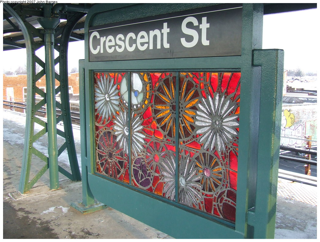 (238k, 1044x788)<br><b>Country:</b> United States<br><b>City:</b> New York<br><b>System:</b> New York City Transit<br><b>Line:</b> BMT Nassau Street/Jamaica Line<br><b>Location:</b> Crescent Street <br><b>Photo by:</b> John Barnes<br><b>Date:</b> 3/7/2007<br><b>Artwork:</b> <i>Wheel of Bloom; Soak up the Sun</i>, Jung Hyang Kim (2007).<br><b>Viewed (this week/total):</b> 0 / 1700