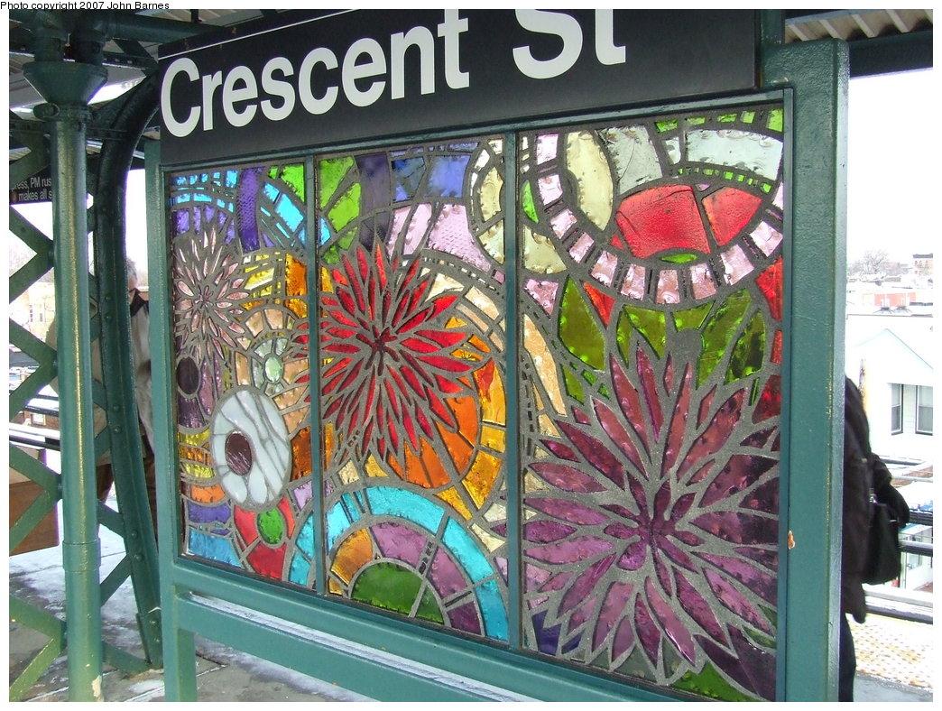 (253k, 1044x788)<br><b>Country:</b> United States<br><b>City:</b> New York<br><b>System:</b> New York City Transit<br><b>Line:</b> BMT Nassau Street/Jamaica Line<br><b>Location:</b> Crescent Street <br><b>Photo by:</b> John Barnes<br><b>Date:</b> 3/7/2007<br><b>Artwork:</b> <i>Wheel of Bloom; Soak up the Sun</i>, Jung Hyang Kim (2007).<br><b>Viewed (this week/total):</b> 4 / 1680