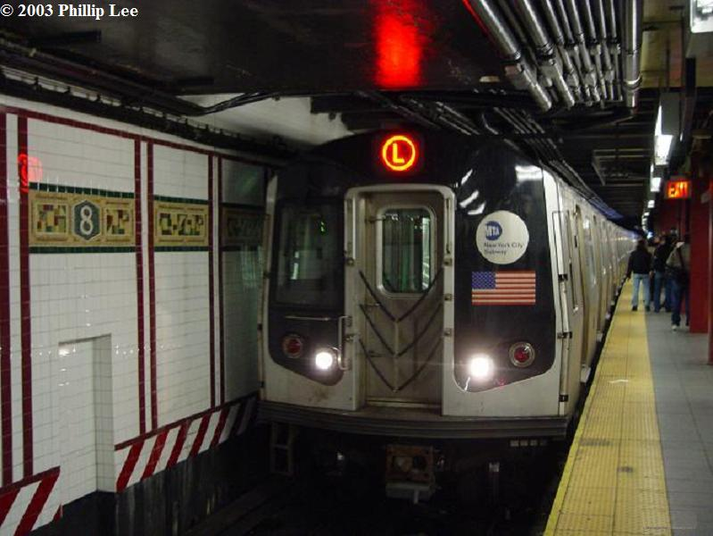 (63k, 799x600)<br><b>Country:</b> United States<br><b>City:</b> New York<br><b>System:</b> New York City Transit<br><b>Line:</b> BMT Canarsie Line<br><b>Location:</b> 8th Avenue <br><b>Route:</b> L<br><b>Car:</b> R-143 (Kawasaki, 2001-2002)  <br><b>Photo by:</b> Phillip Lee<br><b>Date:</b> 12/28/2003<br><b>Viewed (this week/total):</b> 0 / 2542