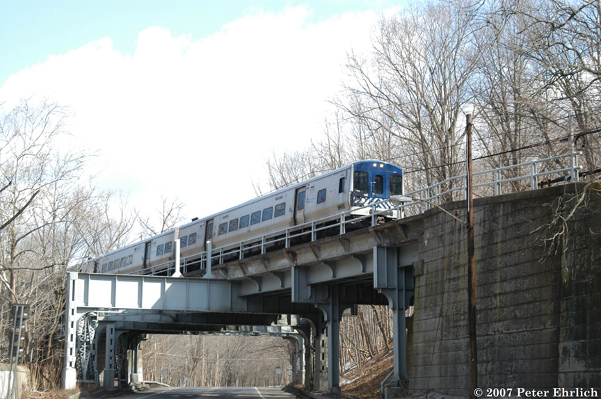 (214k, 864x574)<br><b>Country:</b> United States<br><b>System:</b> Metro-North Railroad (or Amtrak or Predecessor RR)<br><b>Line:</b> Metro North-Harlem Line<br><b>Location:</b> Croton Falls <br><b>Car:</b> MNRR M-7a EMU (Bombardier) 4042 <br><b>Photo by:</b> Peter Ehrlich<br><b>Date:</b> 3/5/2007<br><b>Notes:</b> Southbound train crossing bridge over US202 north of Croton Falls.<br><b>Viewed (this week/total):</b> 2 / 1385