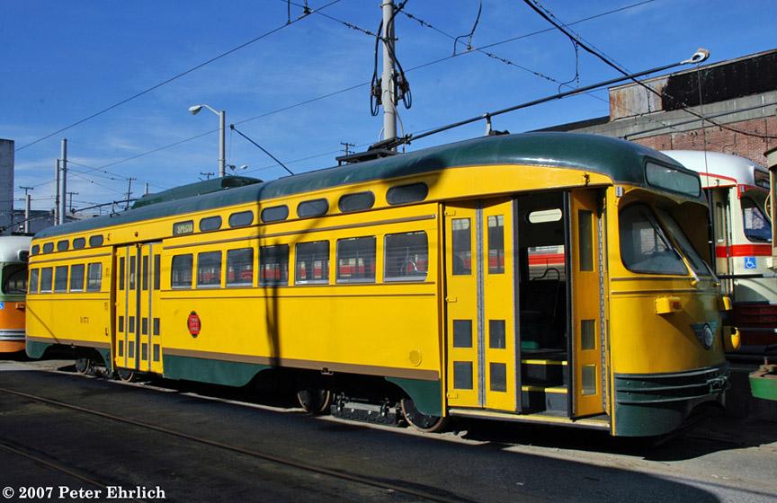 (200k, 864x560)<br><b>Country:</b> United States<br><b>City:</b> San Francisco/Bay Area, CA<br><b>System:</b> SF MUNI<br><b>Location:</b> Geneva Yard <br><b>Car:</b> SF MUNI PCC (Ex-NJTransit, Ex-Twin City) (St. Louis Car Co., 1946-1947)  1071 <br><b>Photo by:</b> Peter Ehrlich<br><b>Date:</b> 3/12/2007<br><b>Notes:</b> At Geneva Yard, after delivery.<br><b>Viewed (this week/total):</b> 0 / 2162