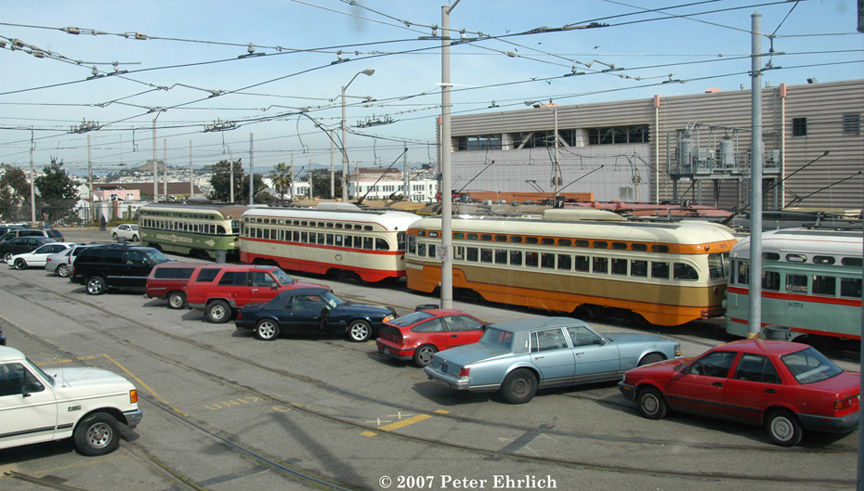(187k, 864x491)<br><b>Country:</b> United States<br><b>City:</b> San Francisco/Bay Area, CA<br><b>System:</b> SF MUNI<br><b>Location:</b> Geneva Yard <br><b>Car:</b> SF MUNI PCC (Ex-NJTransit, Ex-Twin City) (St. Louis Car Co., 1946-1947)  1075 <br><b>Photo by:</b> Peter Ehrlich<br><b>Date:</b> 3/8/2007<br><b>Notes:</b> Cleveland, Detroit, San Diego cars in Geneva Yard, trailing view.<br><b>Viewed (this week/total):</b> 0 / 496