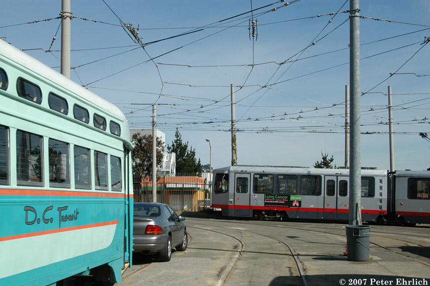 (180k, 864x574)<br><b>Country:</b> United States<br><b>City:</b> San Francisco/Bay Area, CA<br><b>System:</b> SF MUNI<br><b>Location:</b> Geneva Yard <br><b>Car:</b> SF MUNI PCC (Ex-NJTransit, Ex-Twin City) (St. Louis Car Co., 1946-1947)  1076 <br><b>Photo by:</b> Peter Ehrlich<br><b>Date:</b> 3/8/2007<br><b>Notes:</b> 1076 with other cars pulling out of yard.<br><b>Viewed (this week/total):</b> 0 / 337