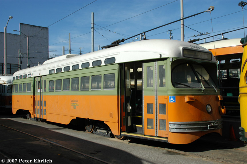 (176k, 864x574)<br><b>Country:</b> United States<br><b>City:</b> San Francisco/Bay Area, CA<br><b>System:</b> SF MUNI<br><b>Location:</b> Geneva Yard <br><b>Car:</b> SF MUNI PCC (Ex-NJTransit, Ex-Twin City) (St. Louis Car Co., 1946-1947)  1080 <br><b>Photo by:</b> Peter Ehrlich<br><b>Date:</b> 3/12/2007<br><b>Notes:</b> Geneva Yard, two days after delivery.<br><b>Viewed (this week/total):</b> 0 / 960