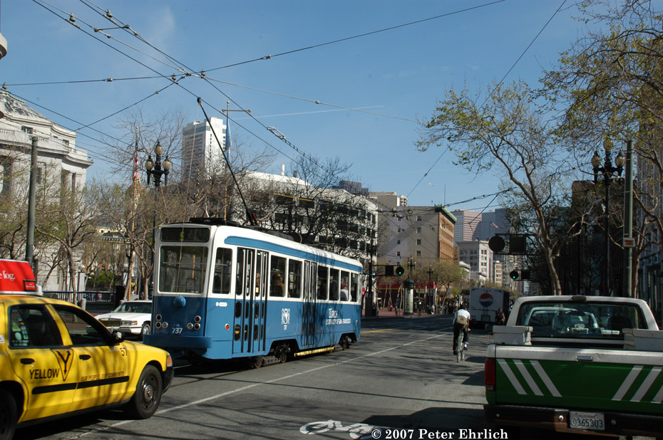 (264k, 930x618)<br><b>Country:</b> United States<br><b>City:</b> San Francisco/Bay Area, CA<br><b>System:</b> SF MUNI<br><b>Location:</b> Market/8th/Hyde/Grove/Civic Ctr. <br><b>Car:</b> Brussels 4-axle PCC (La Brugeoise, 1951)  737 <br><b>Photo by:</b> Peter Ehrlich<br><b>Date:</b> 3/12/2007<br><b>Notes:</b> First revenue run. Market, between 8th and 7th Streets, trailing view.<br><b>Viewed (this week/total):</b> 0 / 610