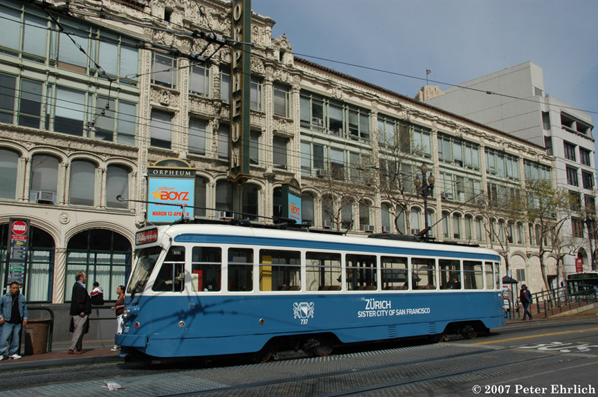 (239k, 864x574)<br><b>Country:</b> United States<br><b>City:</b> San Francisco/Bay Area, CA<br><b>System:</b> SF MUNI<br><b>Location:</b> Market/8th/Hyde/Grove/Civic Ctr. <br><b>Car:</b> Brussels 4-axle PCC (La Brugeoise, 1951)  737 <br><b>Photo by:</b> Peter Ehrlich<br><b>Date:</b> 3/12/2007<br><b>Notes:</b> First revenue run.  Market/8th Street outbound.<br><b>Viewed (this week/total):</b> 2 / 679