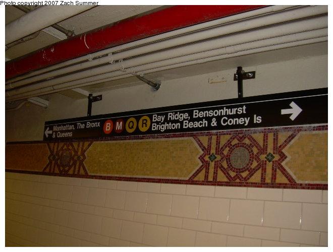 (101k, 660x500)<br><b>Country:</b> United States<br><b>City:</b> New York<br><b>System:</b> New York City Transit<br><b>Location:</b> DeKalb Avenue<br><b>Photo by:</b> Zach Summer<br><b>Date:</b> 8/13/2006<br><b>Notes:</b> Restored mosaic band tile at DeKalb Ave.<br><b>Viewed (this week/total):</b> 1 / 2883