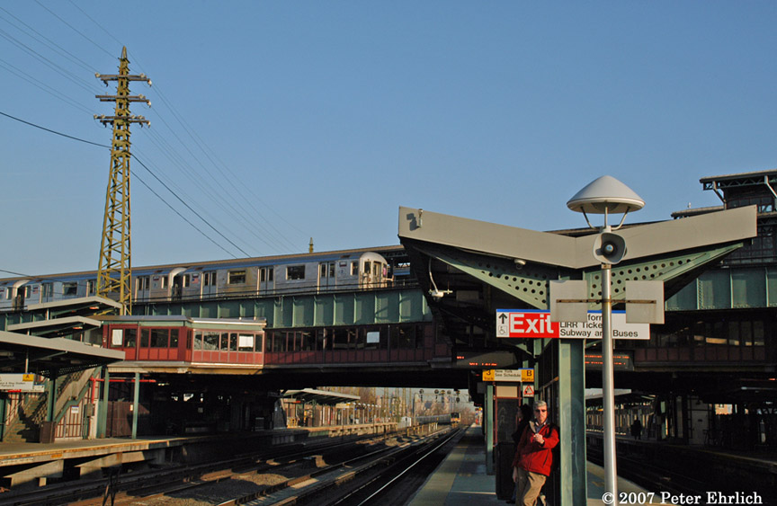 (170k, 864x563)<br><b>Country:</b> United States<br><b>City:</b> New York<br><b>System:</b> New York City Transit<br><b>Line:</b> IRT Flushing Line<br><b>Location:</b> 61st Street/Woodside <br><b>Car:</b> R-62A (Bombardier, 1984-1987)  1980 <br><b>Photo by:</b> Peter Ehrlich<br><b>Date:</b> 4/11/2007<br><b>Notes:</b> Outbound train at 61st/Woodside Station, viewed from LIRR platform.<br><b>Viewed (this week/total):</b> 3 / 2089