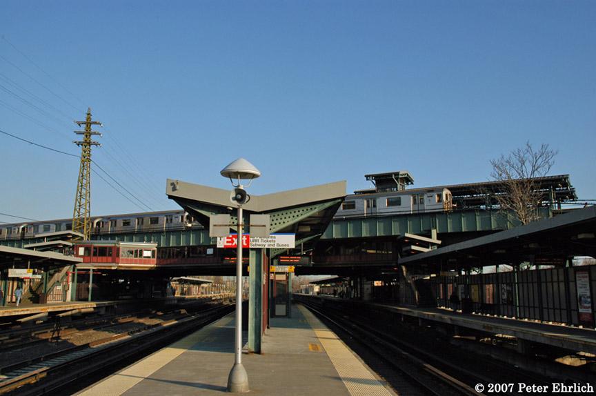 (159k, 864x574)<br><b>Country:</b> United States<br><b>City:</b> New York<br><b>System:</b> New York City Transit<br><b>Line:</b> IRT Flushing Line<br><b>Location:</b> 61st Street/Woodside <br><b>Car:</b> R-62A (Bombardier, 1984-1987)  2030 <br><b>Photo by:</b> Peter Ehrlich<br><b>Date:</b> 4/11/2007<br><b>Notes:</b> Outbound train at 61st/Woodside Station, viewed from LIRR platform.<br><b>Viewed (this week/total):</b> 0 / 2478