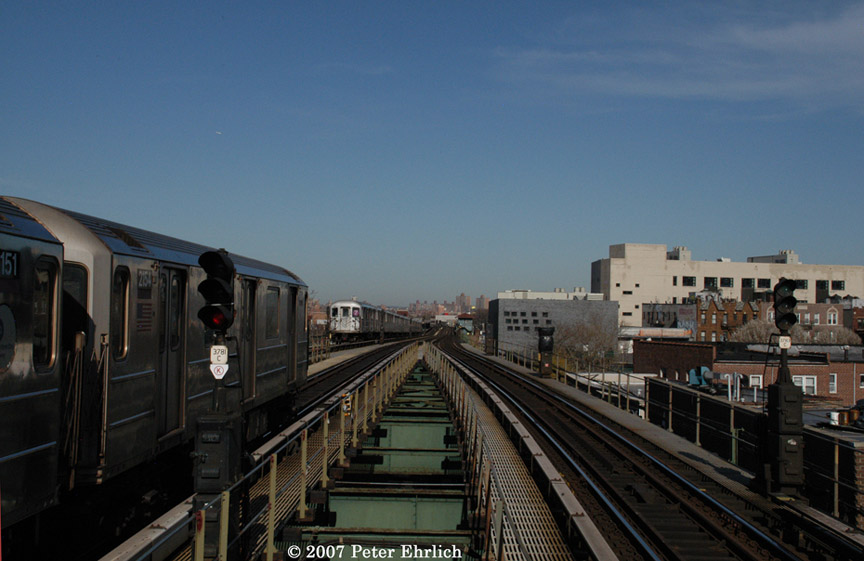 (152k, 864x561)<br><b>Country:</b> United States<br><b>City:</b> New York<br><b>System:</b> New York City Transit<br><b>Line:</b> IRT Flushing Line<br><b>Location:</b> Junction Boulevard <br><b>Car:</b> R-62A (Bombardier, 1984-1987)  2154 <br><b>Photo by:</b> Peter Ehrlich<br><b>Date:</b> 4/20/2007<br><b>Notes:</b> Outbound train leaving Junction Blvd. with an inbound train on left.<br><b>Viewed (this week/total):</b> 2 / 1858