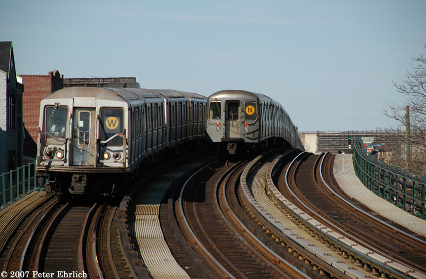 (182k, 864x565)<br><b>Country:</b> United States<br><b>City:</b> New York<br><b>System:</b> New York City Transit<br><b>Line:</b> BMT Astoria Line<br><b>Location:</b> 30th/Grand Aves. <br><b>Car:</b> R-40 (St. Louis, 1968)  4157 <br><b>Photo by:</b> Peter Ehrlich<br><b>Date:</b> 4/20/2007<br><b>Notes:</b> Inbound train passing a layup train, approaching 30th Avenue/Grand Station.<br><b>Viewed (this week/total):</b> 0 / 2977