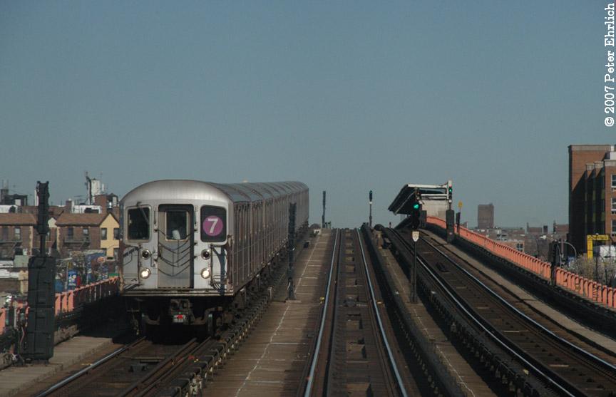 (141k, 864x557)<br><b>Country:</b> United States<br><b>City:</b> New York<br><b>System:</b> New York City Transit<br><b>Line:</b> IRT Flushing Line<br><b>Location:</b> 33rd Street/Rawson Street <br><b>Car:</b> R-62A (Bombardier, 1984-1987)   <br><b>Photo by:</b> Peter Ehrlich<br><b>Date:</b> 4/20/2007<br><b>Notes:</b> Inbound train between 40St/Lowery and 33St/Rawson.<br><b>Viewed (this week/total):</b> 1 / 1643