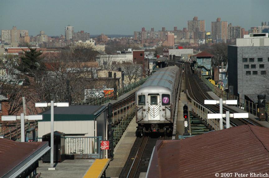 (209k, 864x574)<br><b>Country:</b> United States<br><b>City:</b> New York<br><b>System:</b> New York City Transit<br><b>Line:</b> IRT Flushing Line<br><b>Location:</b> Junction Boulevard <br><b>Car:</b> R-62A (Bombardier, 1984-1987)   <br><b>Photo by:</b> Peter Ehrlich<br><b>Date:</b> 4/20/2007<br><b>Notes:</b> Outbound train leaving Junction Blvd., trailing view.<br><b>Viewed (this week/total):</b> 1 / 2137