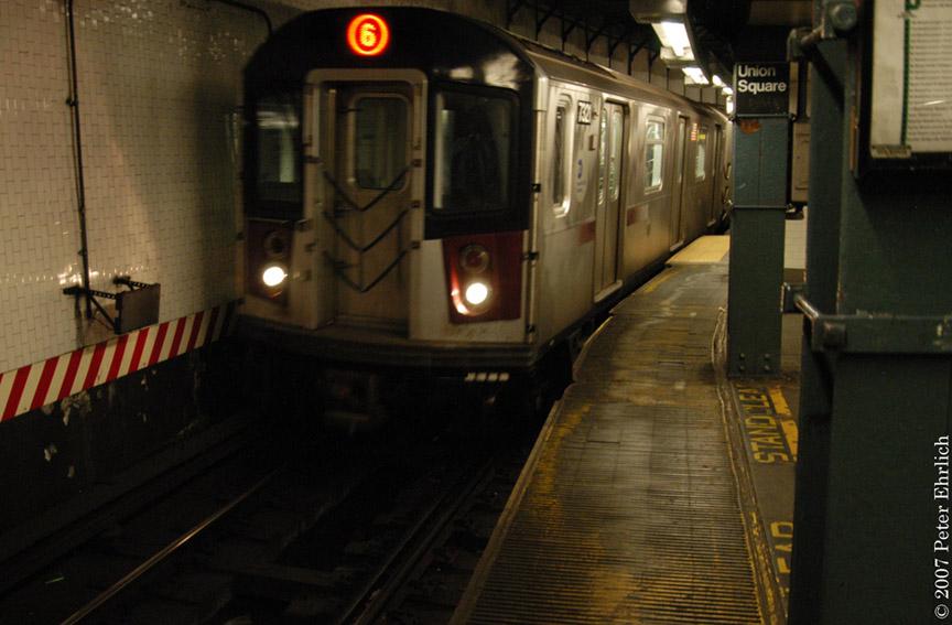 (161k, 864x567)<br><b>Country:</b> United States<br><b>City:</b> New York<br><b>System:</b> New York City Transit<br><b>Line:</b> IRT East Side Line<br><b>Location:</b> 14th Street/Union Square <br><b>Car:</b> R-142A (Primary Order, Kawasaki, 1999-2002)  7321 <br><b>Photo by:</b> Peter Ehrlich<br><b>Date:</b> 4/20/2007<br><b>Notes:</b> Local track gap fillers.<br><b>Viewed (this week/total):</b> 1 / 3572