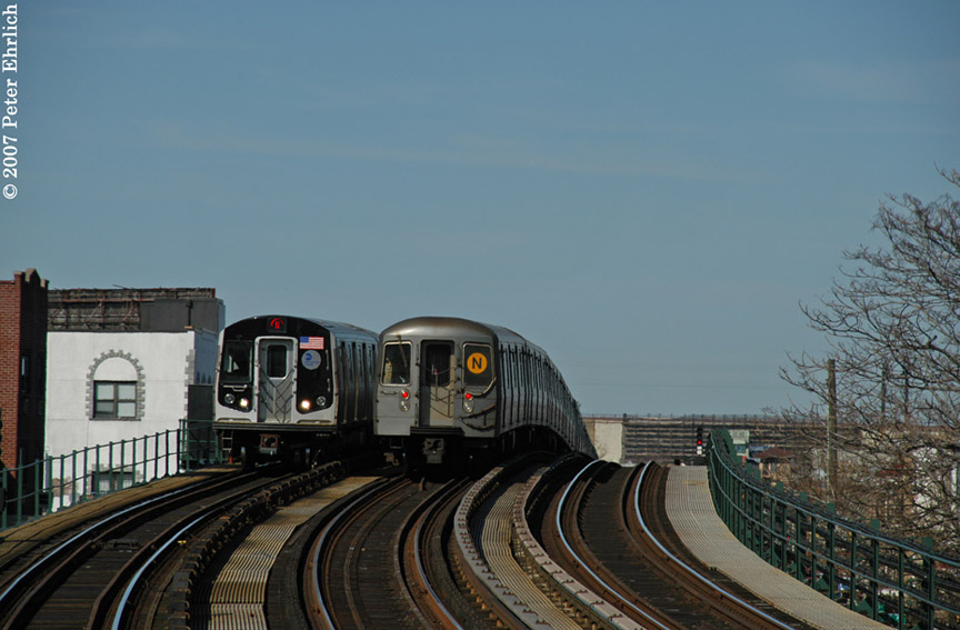 (157k, 864x567)<br><b>Country:</b> United States<br><b>City:</b> New York<br><b>System:</b> New York City Transit<br><b>Line:</b> BMT Astoria Line<br><b>Location:</b> 30th/Grand Aves. <br><b>Car:</b> R-160B (Kawasaki, 2005-2008)  8723 <br><b>Photo by:</b> Peter Ehrlich<br><b>Date:</b> 4/20/2007<br><b>Notes:</b> Inbound train passing a layup train, approaching 30th Avenue/Grand Station.<br><b>Viewed (this week/total):</b> 0 / 2813