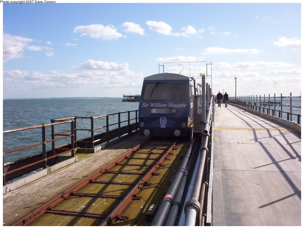 (193k, 1044x788)<br><b>Country:</b> United Kingdom<br><b>City:</b> Southend-on-Sea, Essex<br><b>System:</b> Southend Pier Railway<br><b>Photo by:</b> Dave Carson<br><b>Date:</b> 10/7/2006<br><b>Notes:</b> 1986 Severn-Lamb 7-car diesel train B at the temporary South (Pier Head) station which is shared with the walkway.<br><b>Viewed (this week/total):</b> 1 / 1396