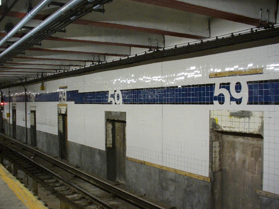 (123k, 900x675)<br><b>Country:</b> United States<br><b>City:</b> New York<br><b>System:</b> New York City Transit<br><b>Line:</b> IND 8th Avenue Line<br><b>Location:</b> 59th Street/Columbus Circle <br><b>Photo by:</b> Robbie Rosenfeld<br><b>Date:</b> 5/7/2007<br><b>Notes:</b> New wall tile at 59th St./Columbus Circle similar to that at 42nd St./Port Authority.<br><b>Viewed (this week/total):</b> 3 / 2111