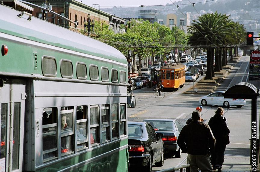 (237k, 864x573)<br><b>Country:</b> United States<br><b>City:</b> San Francisco/Bay Area, CA<br><b>System:</b> SF MUNI<br><b>Location:</b> Market/Church/14th <br><b>Car:</b> SF MUNI PCC (Ex-SEPTA) (St. Louis Car Co., 1947-1948)  1053 <br><b>Photo by:</b> Peter Ehrlich<br><b>Date:</b> 5/16/2007<br><b>Notes:</b> Market/Church.  1053 outbound, trailing view, with Milan 1815 inbound.<br><b>Viewed (this week/total):</b> 0 / 613