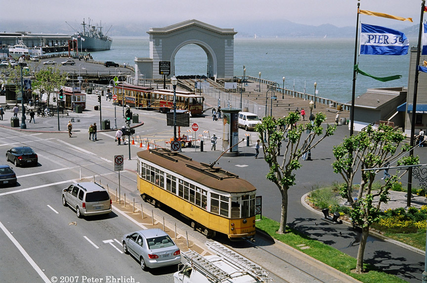(260k, 864x573)<br><b>Country:</b> United States<br><b>City:</b> San Francisco/Bay Area, CA<br><b>System:</b> SF MUNI<br><b>Location:</b> Jefferson/Powell<br><b>Car:</b> Milan Milano/Peter Witt (1927-1930) 1811 <br><b>Photo by:</b> Peter Ehrlich<br><b>Date:</b> 5/9/2007<br><b>Notes:</b> Embarcadero/Powell inbound, with the old Northwestern Pacific freight car slip and the Liberty ship Jeremiah O'Brien in the background.<br><b>Viewed (this week/total):</b> 0 / 749