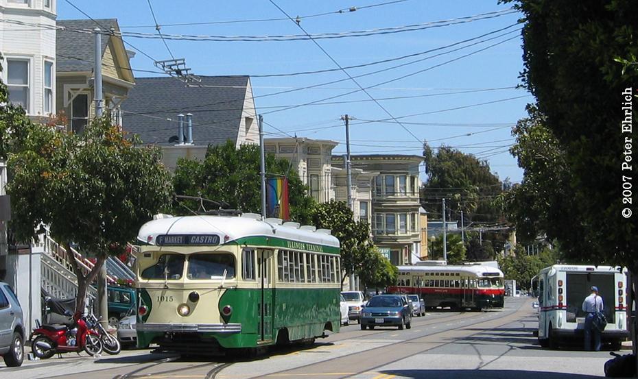 (513k, 930x553)<br><b>Country:</b> United States<br><b>City:</b> San Francisco/Bay Area, CA<br><b>System:</b> SF MUNI<br><b>Location:</b> 17th/Noe <br><b>Car:</b> SF MUNI PCC Torpedo Double-End (St. Louis Car Co., 1948)  1015 <br><b>Photo by:</b> Peter Ehrlich<br><b>Date:</b> 5/5/2007<br><b>Notes:</b> 1015 at the terminal with 1077 turning the corner at 17th and Noe.<br><b>Viewed (this week/total):</b> 0 / 672