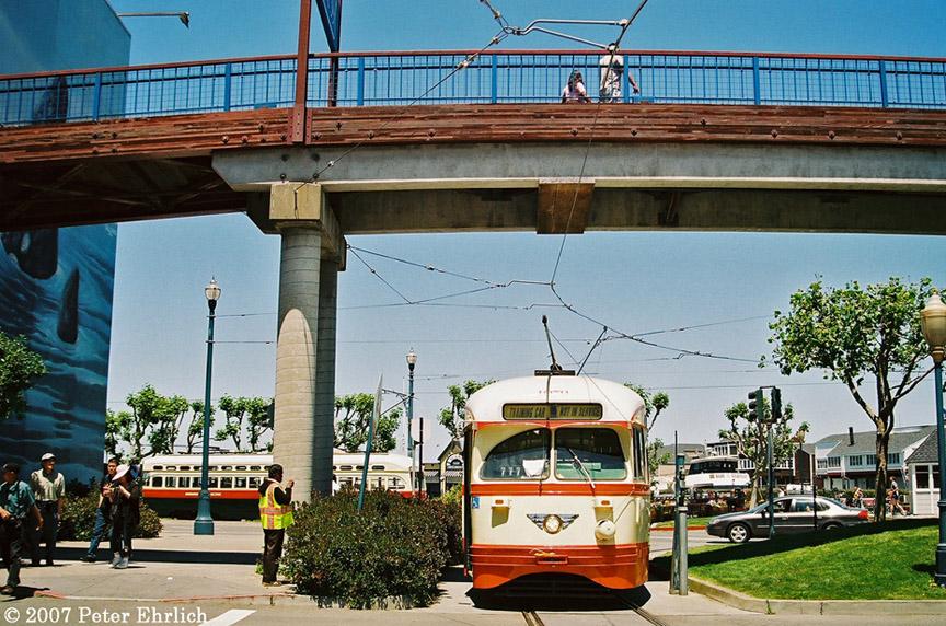 (257k, 864x572)<br><b>Country:</b> United States<br><b>City:</b> San Francisco/Bay Area, CA<br><b>System:</b> SF MUNI<br><b>Location:</b> Embarcadero/Pier 39 <br><b>Car:</b> SF MUNI PCC (Ex-NJTransit, Ex-Twin City) (St. Louis Car Co., 1946-1947)  1079 <br><b>Photo by:</b> Peter Ehrlich<br><b>Date:</b> 5/22/2007<br><b>Notes:</b> Pier 39 loop, with 1077 (Birmingham) passing in the background.<br><b>Viewed (this week/total):</b> 0 / 846