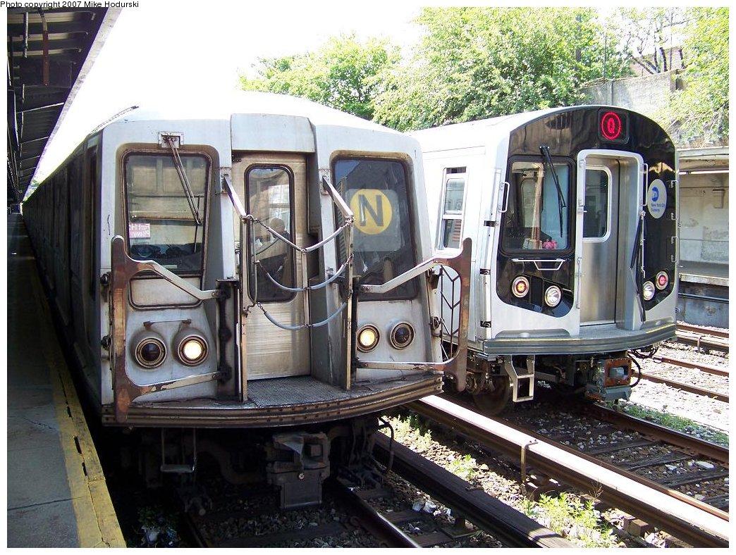 (255k, 1044x788)<br><b>Country:</b> United States<br><b>City:</b> New York<br><b>System:</b> New York City Transit<br><b>Line:</b> BMT Sea Beach Line<br><b>Location:</b> Fort Hamilton Parkway <br><b>Route:</b> N<br><b>Car:</b> R-40 (St. Louis, 1968)  4393 <br><b>Photo by:</b> Michael Hodurski<br><b>Date:</b> 6/7/2007<br><b>Notes:</b> With R160B 8852 on test track.<br><b>Viewed (this week/total):</b> 0 / 2719