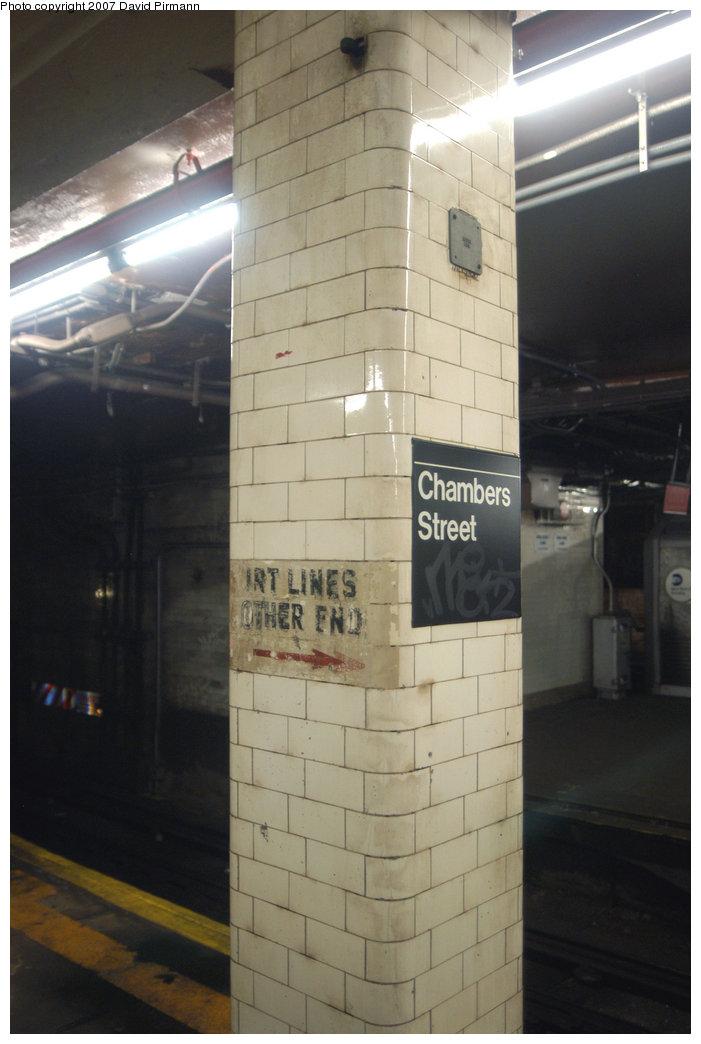 (158k, 701x1044)<br><b>Country:</b> United States<br><b>City:</b> New York<br><b>System:</b> New York City Transit<br><b>Line:</b> BMT Nassau Street/Jamaica Line<br><b>Location:</b> Chambers Street <br><b>Photo by:</b> David Pirmann<br><b>Date:</b> 6/9/2007<br><b>Notes:</b> Column with sign IRT Lines Other End which predates the new north end transfer corridor to IRT.<br><b>Viewed (this week/total):</b> 2 / 1683