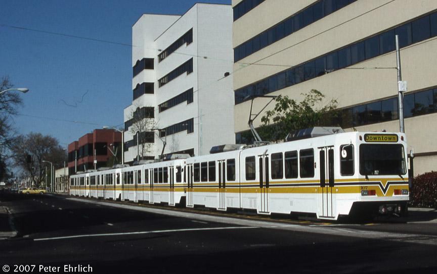 (161k, 864x543)<br><b>Country:</b> United States<br><b>City:</b> Sacramento, CA<br><b>System:</b> SACRT Light Rail<br><b>Location:</b> 12th & I <br><b>Car:</b> Sacramento Siemens LRV  107 <br><b>Photo by:</b> Peter Ehrlich<br><b>Date:</b> 4/4/1987<br><b>Notes:</b> 12th & I Station, trailing view.<br><b>Viewed (this week/total):</b> 2 / 1199