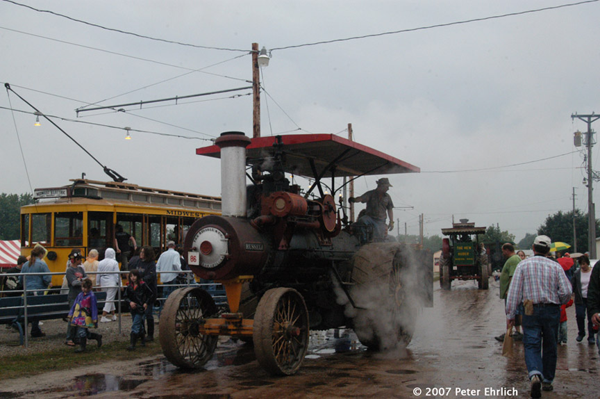 (166k, 864x574)<br><b>Country:</b> United States<br><b>City:</b> Mt. Pleasant, IA<br><b>System:</b> Midwest Old Threshers Museum <br><b>Car:</b>  1779 <br><b>Photo by:</b> Peter Ehrlich<br><b>Date:</b> 9/3/2006<br><b>Notes:</b> At the Fairgrounds Streetcar Depot outbound stop, with steam tractors parading in foreground.<br><b>Viewed (this week/total):</b> 2 / 996