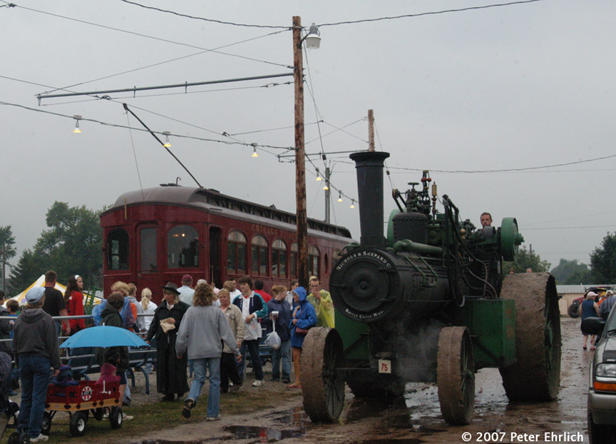 (177k, 864x622)<br><b>Country:</b> United States<br><b>City:</b> Mt. Pleasant, IA<br><b>System:</b> Midwest Old Threshers Museum <br><b>Car:</b>  320 <br><b>Photo by:</b> Peter Ehrlich<br><b>Date:</b> 9/3/2006<br><b>Notes:</b> At the Fairgrounds Streetcar Depot outbound stop, with steam tractors parading in foreground.<br><b>Viewed (this week/total):</b> 2 / 951