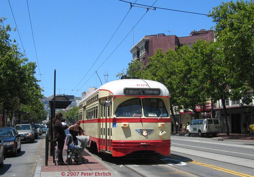 (232k, 864x603)<br><b>Country:</b> United States<br><b>City:</b> San Francisco/Bay Area, CA<br><b>System:</b> SF MUNI<br><b>Location:</b> Market/Van Ness <br><b>Car:</b> SF MUNI PCC (Ex-NJTransit, Ex-Twin City) (St. Louis Car Co., 1946-1947)  1079 <br><b>Photo by:</b> Peter Ehrlich<br><b>Date:</b> 6/14/2007<br><b>Notes:</b> Market/Van Ness inbound.<br><b>Viewed (this week/total):</b> 0 / 714