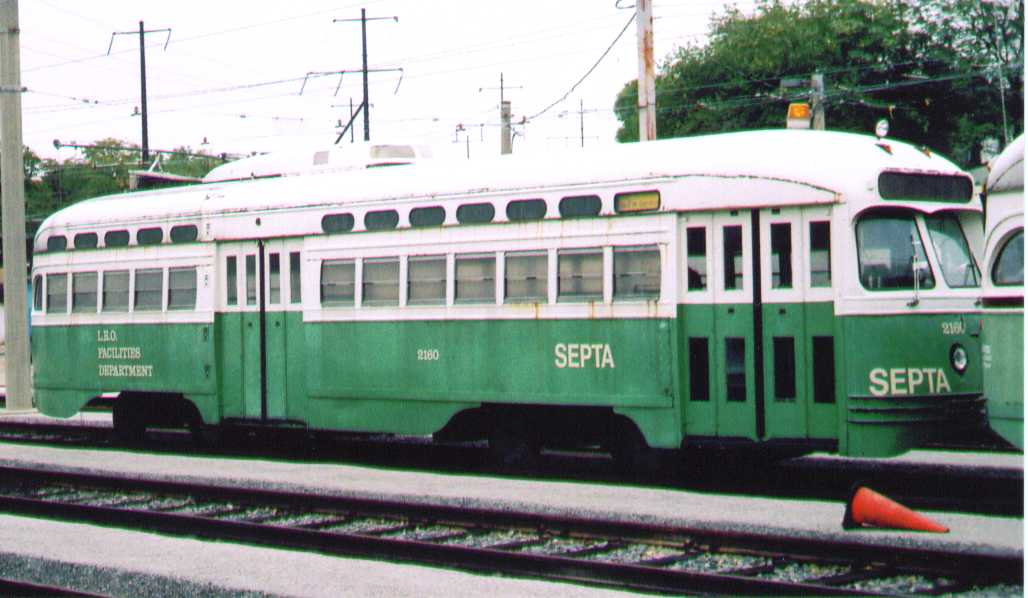 (59k, 1028x598)<br><b>Country:</b> United States<br><b>City:</b> Philadelphia, PA<br><b>System:</b> SEPTA (or Predecessor)<br><b>Location:</b> Elmwood Depot <br><b>Car:</b> PTC/SEPTA Postwar All-electric PCC (St.Louis, 1948)  2180 <br><b>Photo by:</b> Bob Wright<br><b>Date:</b> 10/2005<br><b>Viewed (this week/total):</b> 0 / 1697