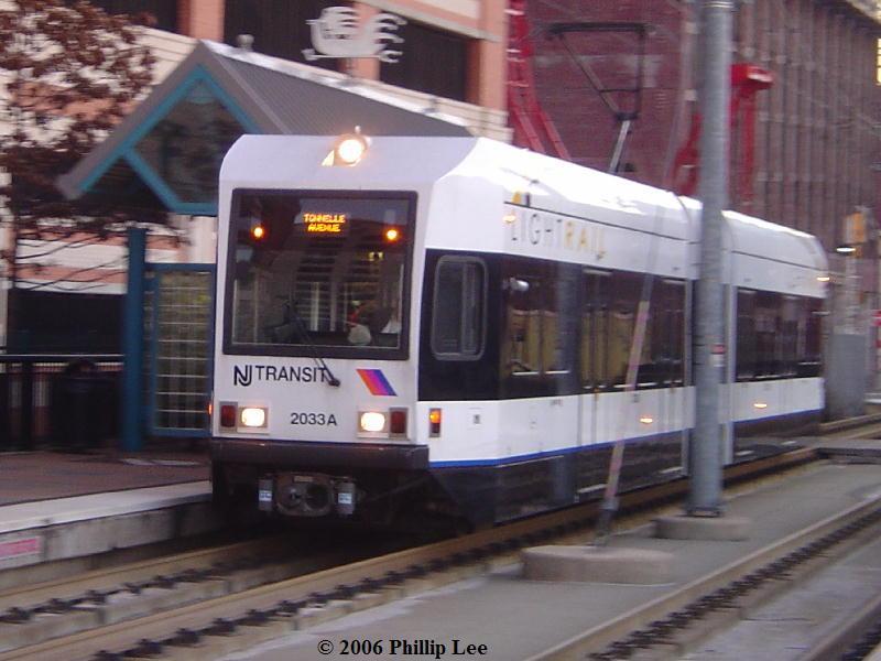 (74k, 800x600)<br><b>Country:</b> United States<br><b>City:</b> Jersey City, NJ<br><b>System:</b> Hudson Bergen Light Rail<br><b>Location:</b> Harsimus Cove <br><b>Car:</b> NJT-HBLR LRV (Kinki-Sharyo, 1998-99)  2033 <br><b>Photo by:</b> Phillip Lee<br><b>Date:</b> 12/23/2006<br><b>Viewed (this week/total):</b> 0 / 954