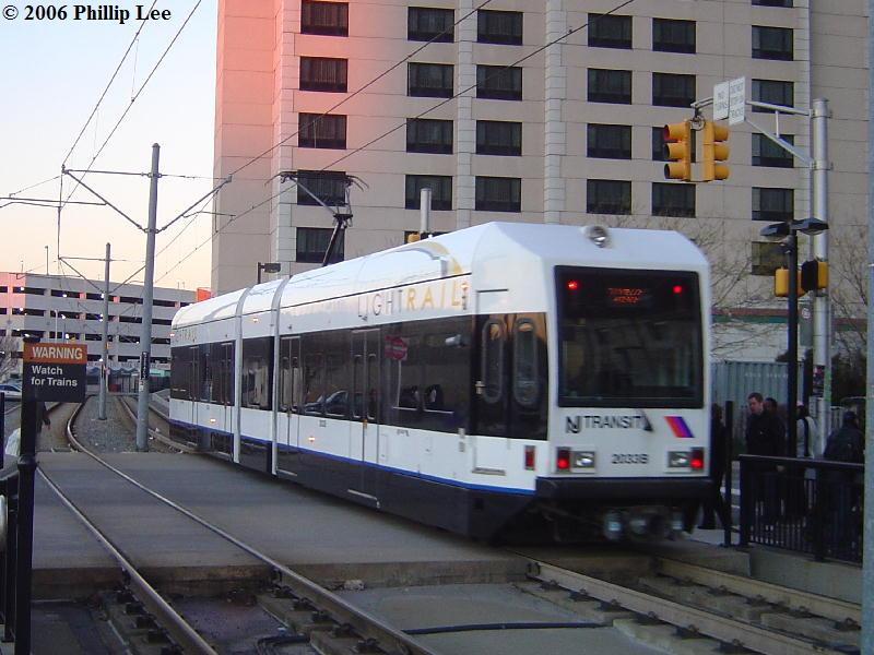 (85k, 800x600)<br><b>Country:</b> United States<br><b>City:</b> Jersey City, NJ<br><b>System:</b> Hudson Bergen Light Rail<br><b>Location:</b> Harsimus Cove <br><b>Car:</b> NJT-HBLR LRV (Kinki-Sharyo, 1998-99)  2033 <br><b>Photo by:</b> Phillip Lee<br><b>Date:</b> 12/23/2006<br><b>Viewed (this week/total):</b> 1 / 1044