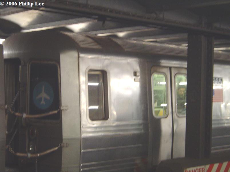 (51k, 804x603)<br><b>Country:</b> United States<br><b>City:</b> New York<br><b>System:</b> New York City Transit<br><b>Line:</b> IND 6th Avenue Line<br><b>Location:</b> Broadway/Lafayette <br><b>Route:</b> D<br><b>Car:</b> R-68 (Westinghouse-Amrail, 1986-1988)  2665 <br><b>Photo by:</b> Phillip Lee<br><b>Date:</b> 12/11/2006<br><b>Notes:</b> Note JFK Train to the Plane rollsign on R68 car-- which never served in Train to the Plane service.<br><b>Viewed (this week/total):</b> 2 / 3676