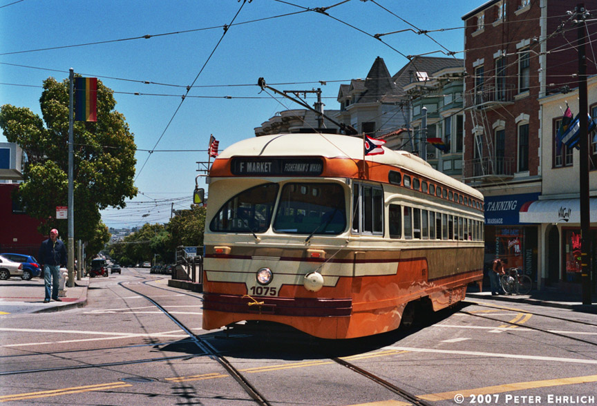 (236k, 864x588)<br><b>Country:</b> United States<br><b>City:</b> San Francisco/Bay Area, CA<br><b>System:</b> SF MUNI<br><b>Location:</b> Market/17th/Castro <br><b>Car:</b> SF MUNI PCC (Ex-NJTransit, Ex-Twin City) (St. Louis Car Co., 1946-1947)  1075 <br><b>Photo by:</b> Peter Ehrlich<br><b>Date:</b> 6/30/2007<br><b>Notes:</b> Leaving 17th Street/Castro terminal. 1075 is carrying Ohio state flag.<br><b>Viewed (this week/total):</b> 0 / 1313
