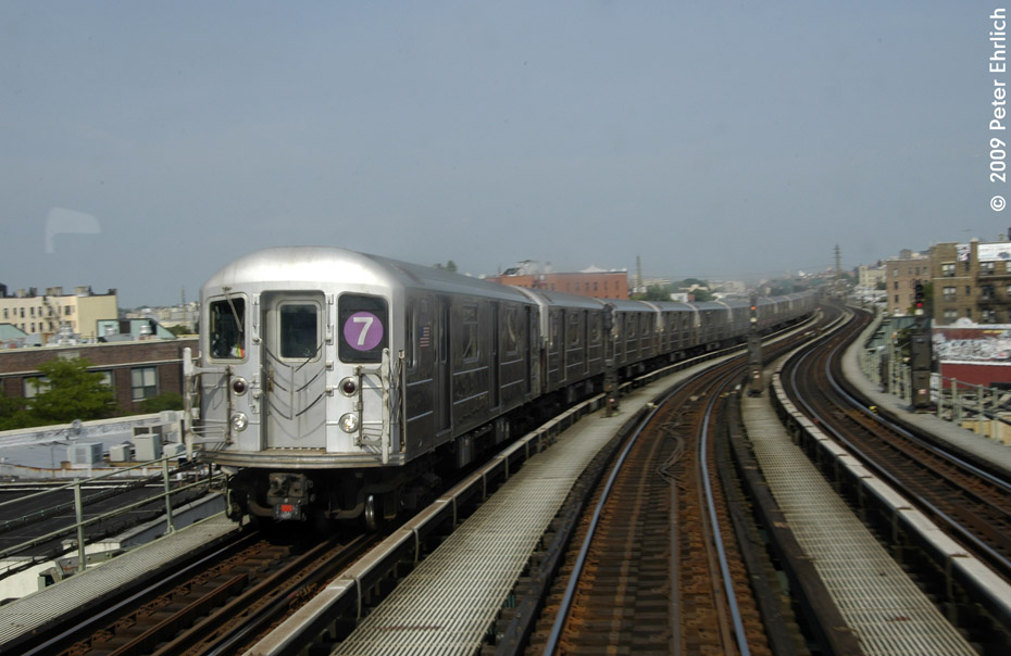 (166k, 930x604)<br><b>Country:</b> United States<br><b>City:</b> New York<br><b>System:</b> New York City Transit<br><b>Line:</b> IRT Flushing Line<br><b>Location:</b> 61st Street/Woodside <br><b>Route:</b> 7<br><b>Car:</b> R-62A (Bombardier, 1984-1987)  1730 <br><b>Photo by:</b> Peter Ehrlich<br><b>Date:</b> 7/22/2009<br><b>Notes:</b> West of 61st Street, inbound<br><b>Viewed (this week/total):</b> 0 / 850
