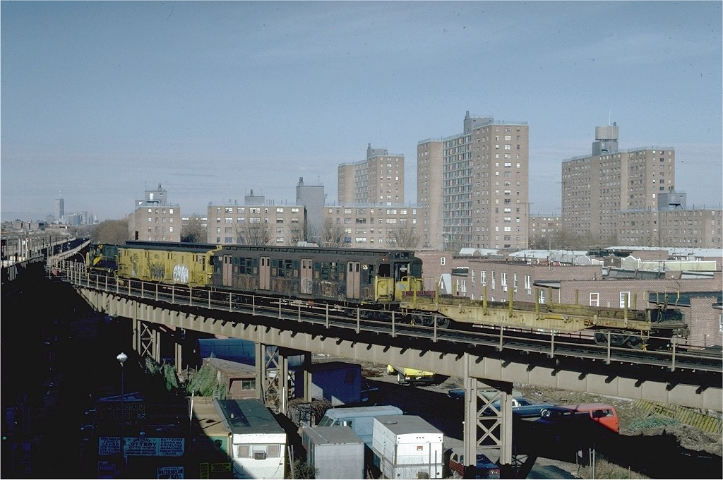 (194k, 1024x680)<br><b>Country:</b> United States<br><b>City:</b> New York<br><b>System:</b> New York City Transit<br><b>Line:</b> BMT West End Line<br><b>Location:</b> Bay 50th Street <br><b>Route:</b> Work Service<br><b>Car:</b> Flat Car 184 <br><b>Photo by:</b> Steve Zabel<br><b>Collection of:</b> Joe Testagrose<br><b>Date:</b> 12/10/1981<br><b>Viewed (this week/total):</b> 0 / 3184