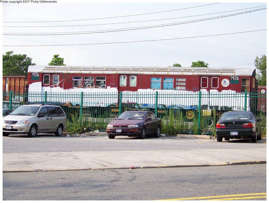 (229k, 1044x788)<br><b>Country:</b> United States<br><b>City:</b> New York<br><b>System:</b> New York City Transit<br><b>Location:</b> LIRR/NY & Atlantic RR Fresh Pond Yard <br><b>Car:</b> R-28 (American Car & Foundry, 1960-61) 7926 <br><b>Photo by:</b> Philip D'Allesandro<br><b>Date:</b> 7/16/2007<br><b>Notes:</b> R28 7926 & 7927 being loaded onto trucks on Otto Road alongside LIRR Fresh Pond Yard, for the trip to Illinois Railway Museum.<br><b>Viewed (this week/total):</b> 5 / 3911