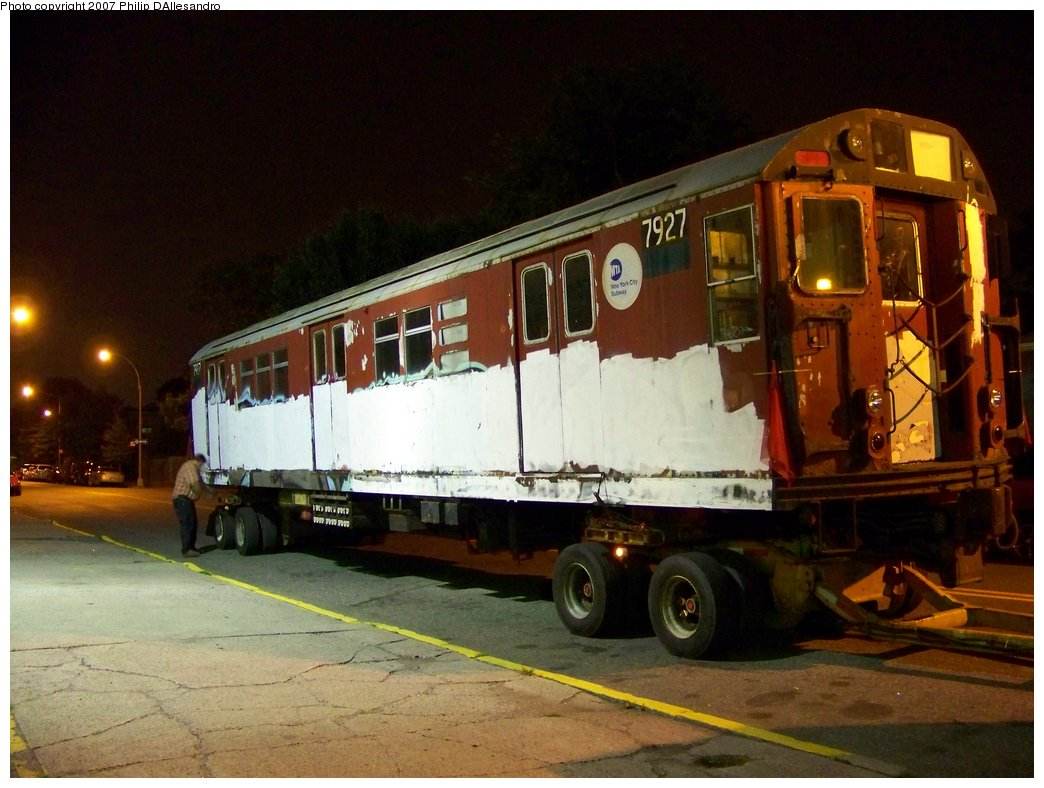 (166k, 1044x788)<br><b>Country:</b> United States<br><b>City:</b> New York<br><b>System:</b> New York City Transit<br><b>Location:</b> LIRR/NY & Atlantic RR Fresh Pond Yard <br><b>Car:</b> R-28 (American Car & Foundry, 1960-61) 7927 <br><b>Photo by:</b> Philip D'Allesandro<br><b>Date:</b> 7/16/2007<br><b>Notes:</b> R28 7926 & 7927 being loaded onto trucks on Otto Road alongside LIRR Fresh Pond Yard, for the trip to Illinois Railway Museum.<br><b>Viewed (this week/total):</b> 2 / 3765