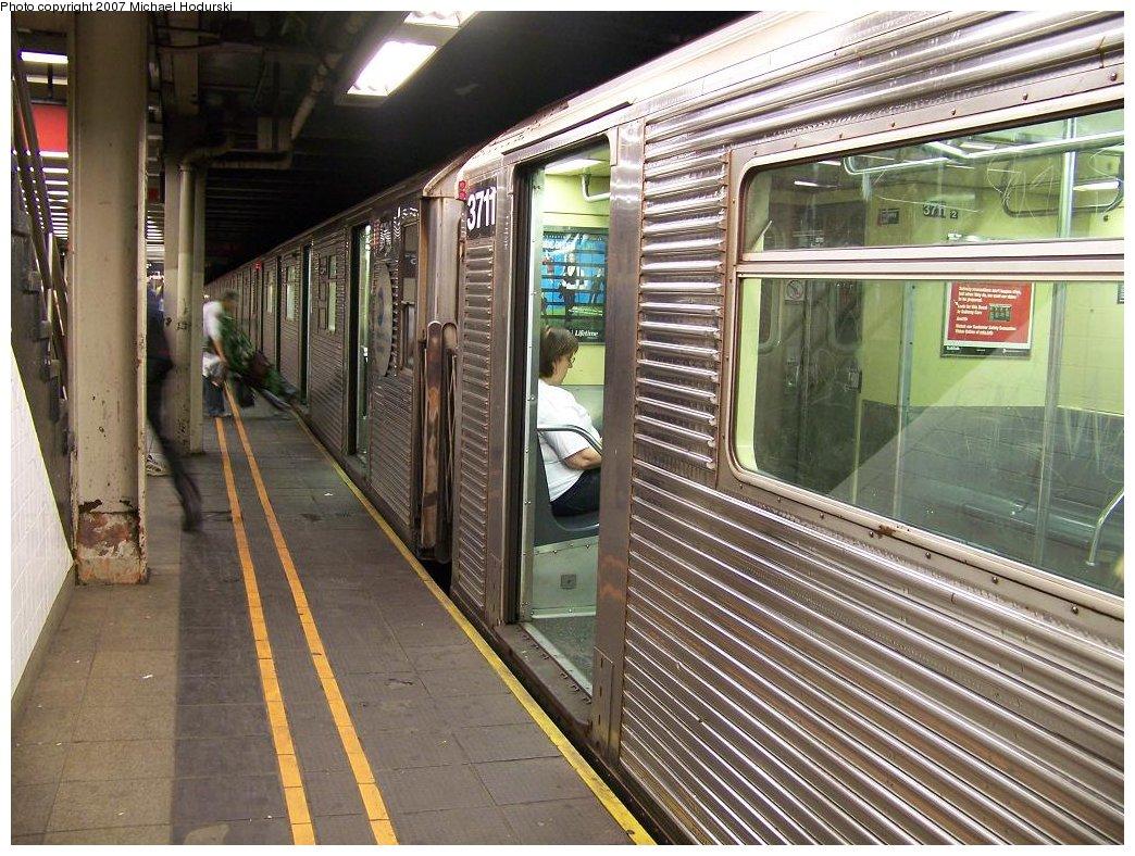 (235k, 1044x788)<br><b>Country:</b> United States<br><b>City:</b> New York<br><b>System:</b> New York City Transit<br><b>Line:</b> BMT Broadway Line<br><b>Location:</b> 57th Street <br><b>Route:</b> W<br><b>Car:</b> R-32 (Budd, 1964)  3711 <br><b>Photo by:</b> Michael Hodurski<br><b>Date:</b> 7/22/2007<br><b>Viewed (this week/total):</b> 0 / 3412