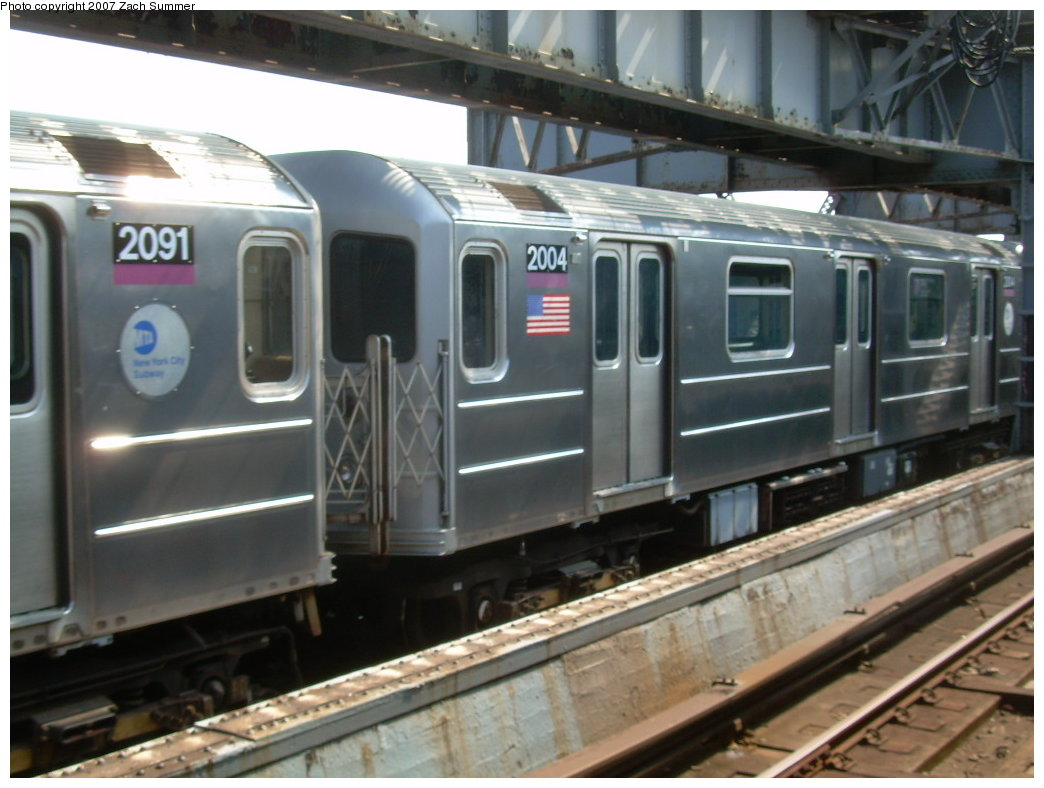 (183k, 1044x788)<br><b>Country:</b> United States<br><b>City:</b> New York<br><b>System:</b> New York City Transit<br><b>Line:</b> IRT Flushing Line<br><b>Location:</b> 111th Street <br><b>Route:</b> 7<br><b>Car:</b> R-62A (Bombardier, 1984-1987)  2004 <br><b>Photo by:</b> Zach Summer<br><b>Date:</b> 6/18/2007<br><b>Viewed (this week/total):</b> 2 / 1890