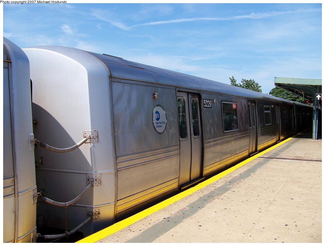 (155k, 1044x788)<br><b>Country:</b> United States<br><b>City:</b> New York<br><b>System:</b> New York City Transit<br><b>Line:</b> IND Rockaway<br><b>Location:</b> Mott Avenue/Far Rockaway <br><b>Route:</b> A<br><b>Car:</b> R-44 (St. Louis, 1971-73) 5229 <br><b>Photo by:</b> Michael Hodurski<br><b>Date:</b> 7/25/2007<br><b>Notes:</b> R44s 5228/9 have a stainless steel band rather than a painted carbon steel band.<br><b>Viewed (this week/total):</b> 0 / 2119