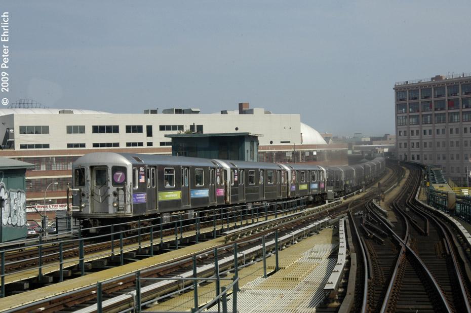 (199k, 930x618)<br><b>Country:</b> United States<br><b>City:</b> New York<br><b>System:</b> New York City Transit<br><b>Line:</b> IRT Flushing Line<br><b>Location:</b> 33rd Street/Rawson Street <br><b>Route:</b> 7<br><b>Car:</b> R-62A (Bombardier, 1984-1987)  1765 <br><b>Photo by:</b> Peter Ehrlich<br><b>Date:</b> 7/22/2009<br><b>Notes:</b> Inbound train having just left 33rd/Rawson<br><b>Viewed (this week/total):</b> 1 / 1194