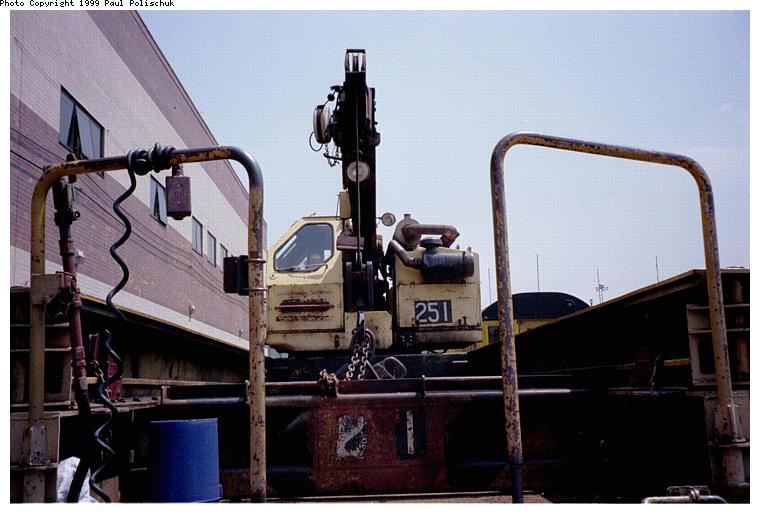 (73k, 760x514)<br><b>Country:</b> United States<br><b>City:</b> New York<br><b>System:</b> New York City Transit<br><b>Location:</b> Corona Yard<br><b>Car:</b> Crane Car 251 <br><b>Photo by:</b> Paul Polischuk<br><b>Date:</b> 6/25/1999<br><b>Viewed (this week/total):</b> 2 / 3604
